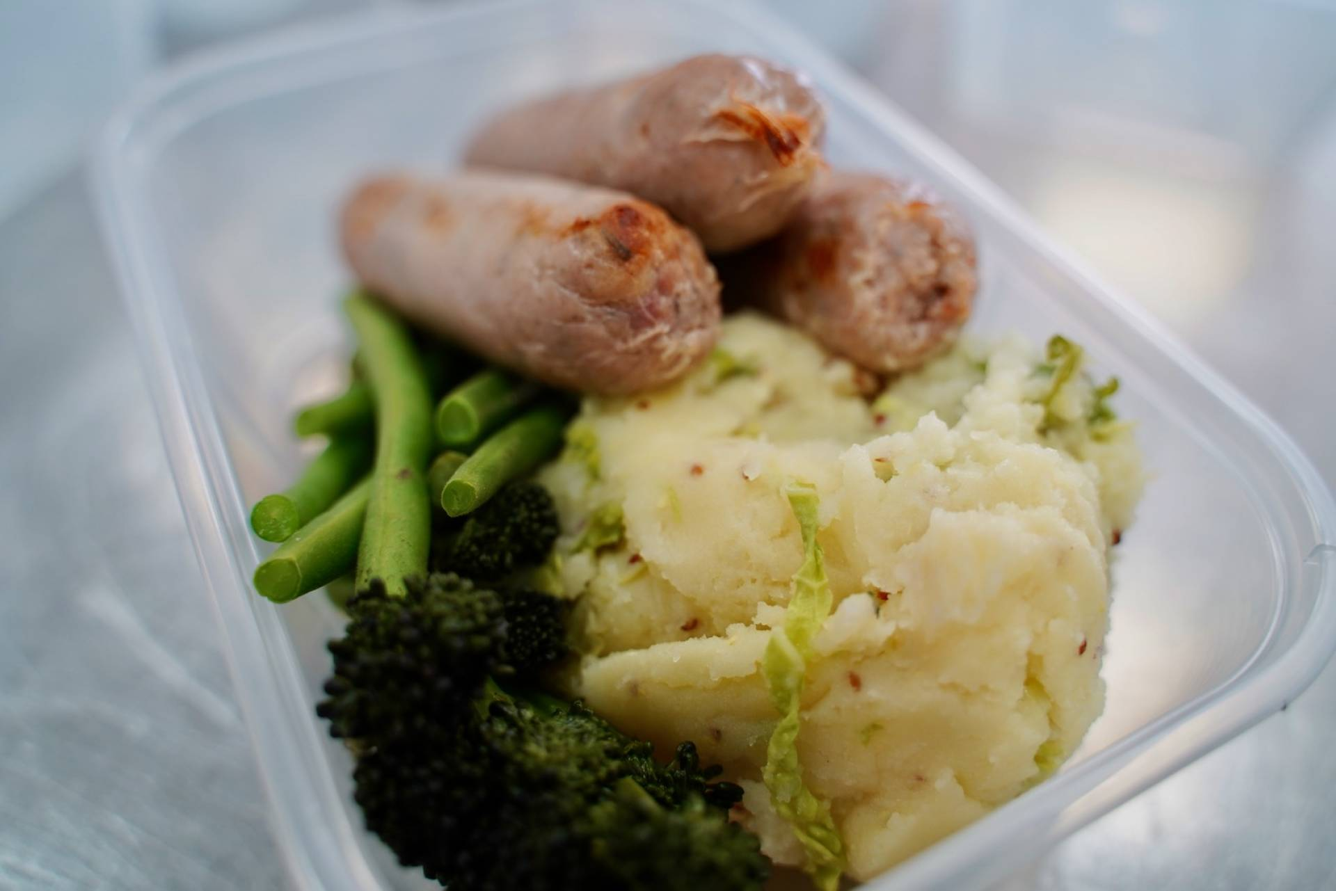 Caramelised Onion Turkey Sausages with Mash & Greens